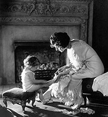 Mother Counting Child's Toes, Circa 1915 Stock Photo