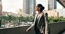 Businesswoman looking out from walkway, Los Angeles, USA Stock Photo