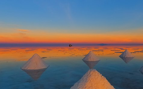 Piles of salt at sunrise. Stock Photo